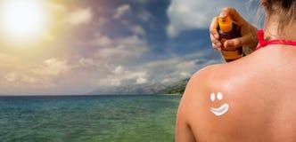 Girl with sunburned skin Stock Images