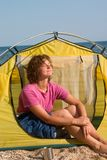 Girl sunburning in the morning near of tent Royalty Free Stock Image