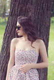 Girl in the sundress and in the sunglasses looks aside Royalty Free Stock Image