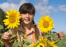 The girl with sunflower Royalty Free Stock Image