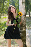 Girl with sunflower Royalty Free Stock Image