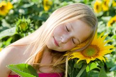 Girl and sunflower Royalty Free Stock Images