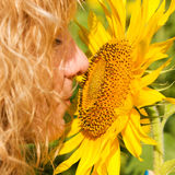 Girl and Sunflower Stock Photos