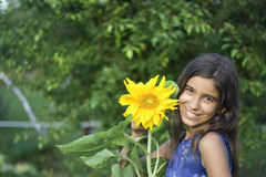 Girl with sunflower Royalty Free Stock Photography