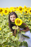Girl with sunflower. Girl staying near sunflower in sunny weather Royalty Free Stock Photos