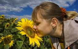 Girl and sunflower royalty free stock photography