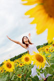 Girl in sunflower field Stock Photos