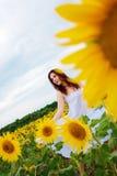 Girl in sunflower field Stock Image