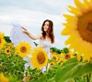 Girl in sunflower field Stock Images