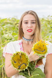Girl on a sunflower field. Young cute girl posing in sunflower field Royalty Free Stock Photography