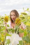 Girl on a sunflower field. Young cute girl posing in sunflower field Royalty Free Stock Photos