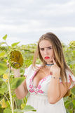 Girl on a sunflower field Royalty Free Stock Photography