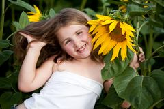 Girl and sunflower Royalty Free Stock Image