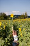 Girl and sunflower Stock Photo