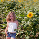 Girl and sunflower Royalty Free Stock Photos
