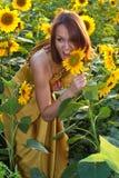 Girl in sunflowers Stock Photo