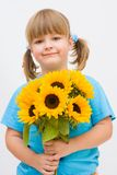 Girl and sunflowers. Portrait of a sweet, little girl with sunflowers Royalty Free Stock Photography