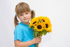Girl and sunflowers Royalty Free Stock Photography