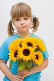 Girl and sunflowers. Portrait of a sweet, little girl with sunflowers Stock Image