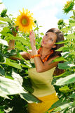 Girl in sunflowers. Pretty girl in sunflowers. Sunny summer day Stock Photo