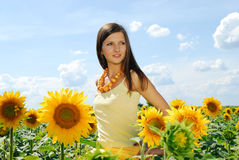 Girl in sunflowers. Sunny summer day Stock Photo