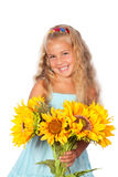 Girl with sunflowers. A beautiful little girl smiling and holding a bunch of sunflowers stock photo