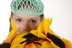 Girl with sunflowers. Portrait of a little girl with sunflowers royalty free stock photos