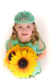 Girl with sunflowers. Portrait of a little girl with sunflowers Royalty Free Stock Images