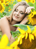 Girl with a sunflowers Stock Photos