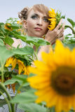 Girl with a sunflowers Royalty Free Stock Image