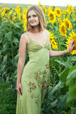Girl with sunflowers Royalty Free Stock Photos
