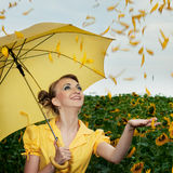 Girl with sunflowers Royalty Free Stock Images