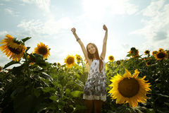 Girl and sunflowers Royalty Free Stock Images