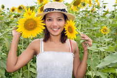 Girl with sunflowers. Girl in the field of sunflowers Stock Photos