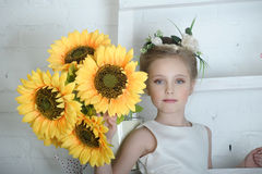 Girl with sunflowers Stock Images