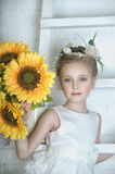 Girl with sunflowers. Portrait of a girl with sunflowers Royalty Free Stock Images
