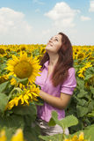 Girl in sunflowers. Beautiful girl in a field of sunflowers Royalty Free Stock Photo