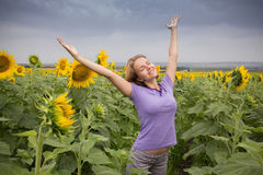 Girl in sunflowers Royalty Free Stock Photography