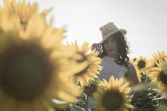 Girl at sunflowers field Royalty Free Stock Images