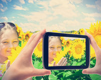 Girl in sunflowers Royalty Free Stock Photo