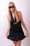 Girl in sunglasses. Girl in a black dress and sunglasses Royalty Free Stock Photos