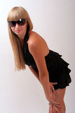 Girl in sunglasses. Girl in a black dress and sunglasses Stock Photos