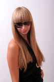 Girl in sunglasses. Girl in a black dress and sunglasses Stock Images