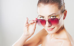 Girl with sunglasses Stock Images