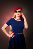 Girl in sunglasses. Beautiful girl in sunglasses and in red Beanie Stock Photography