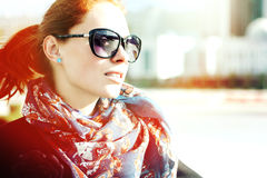 Girl In Sunglasses. Portrait of an attractive young woman in sunglasses outdoors Royalty Free Stock Photography