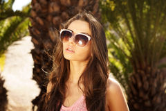 Girl in sunglasses. Portrait of young beautiful girl in sunglasses with backlight Royalty Free Stock Photography