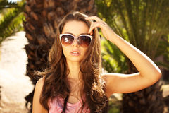 Girl in sunglasses. Portrait of young beautiful girl in sunglasses with backlight Stock Image
