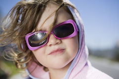 Girl In Sunglasses Against Blue Sky Stock Photos