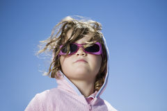 Girl In Sunglasses Against Clear Blue Sky Royalty Free Stock Photography